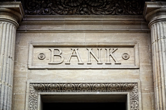Stone relief of the word 'Bank' between two Grecian columns.